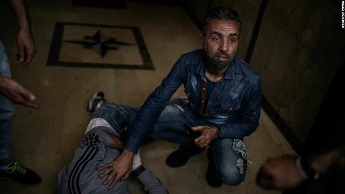 A protester lies on the floor after being wounded by a rubber bullet in Tripoli.