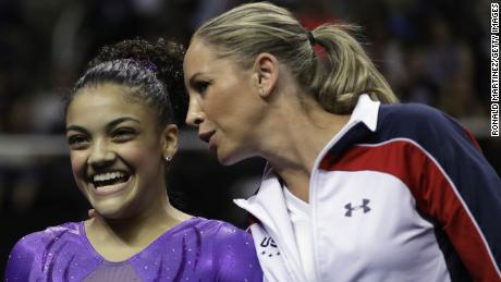 Maggie Haney, right, speaks with gymnast Laurie Hernandez during the 2016 US Olympic Women's Gymnastics Team Trials in San Jose, California.