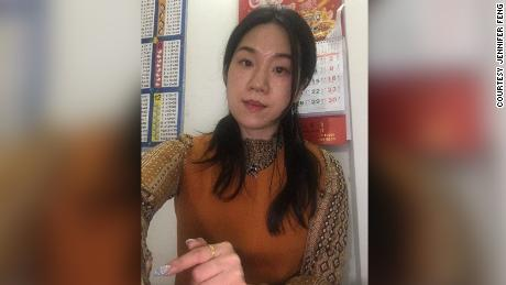 Jennifer Feng, 38, a nail technician at a mall salon in Flushing, takes a photo at home on April 30, 2020. (Jennifer Feng)
