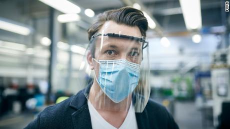 A Ford of Europe employee wearing protective equipment similar to that US employees will be required to wear.