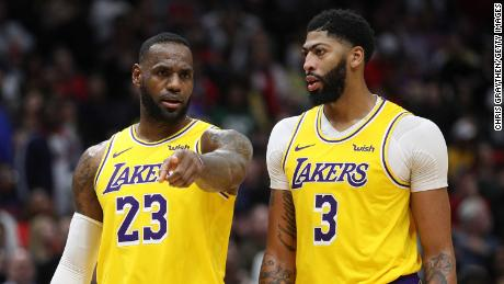 Anthony Davis #3 of the Los Angeles Lakers and LeBron James #23 of the Los Angeles Lakers talk during the game against the New Orleans Pelicans at Smoothie King Center on November 27, 2019 in New Orleans, Louisiana.