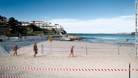 A group of men walk on Bondi Beach on May 01 in Sydney, Australia, following the easing of lockdown measures in response to a decline in coronavirus cases across the state.