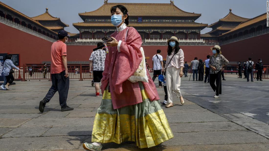 BEIJING, CHINA - MAY 01: A Chinese tourist wears a protective mask before entering the Forbidden City as it re-opened to limited visitors or the May holiday, on May 1, 2020 in Beijing, China. Beijing lowered its risk level after more than three months Thursday in advance of the May holiday, allowing most domestic travellers arriving in the city to do so without having to do 14 days quarantine. The Forbidden City opened to a limited number of visitors Friday morning for the first time in more than three months. After decades of growth, officials said Chinas economy had shrunk in the latest quarter due to the impact of the coronavirus epidemic. The slump in the worlds second largest economy is regarded as a sign of difficult times ahead for the global economy. While industrial sectors in China are showing signs of reviving production, a majority of private companies are operating at only 50% capacity, according to analysts. With the pandemic hitting hard across the world, officially the number of coronavirus cases in China is dwindling, ever since the government imposed sweeping measures to keep the disease from spreading. Officials believe the worst appears to be over in China, though there are concerns of another wave of infections as the government attempts to reboot the worlds second largest economy. Since January, China has recorded more than 81,000 cases of COVID-19 and at least 3200 deaths, mostly in and around the city of Wuhan, in central Hubei province, where the outbreak first started. (Photo by Kevin Frayer/Getty Images)