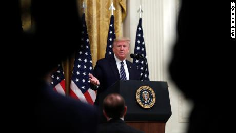 President Donald Trump answers questions from reporters during a event about protecting seniors, in the East Room of the White House, Thursday, April 30, 2020, in Washington.