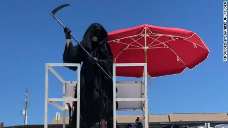 A lawyer dressed as the Grim Reaper is haunting Florida beaches to protest their reopening