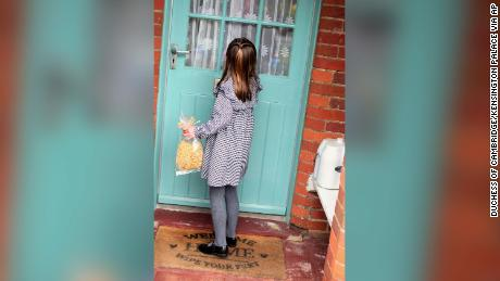 Princess Charlotte approaches a door with a bag of pasta.