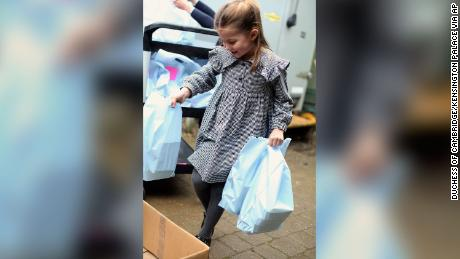 The young royal helped her family pack and deliver food.