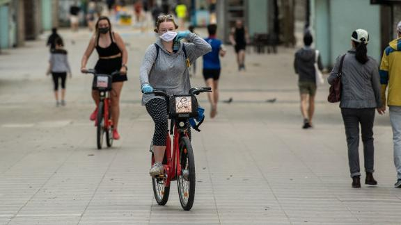 A woman rides a city bike on La Ramblas on May 2 in Barcelona, Spain as the country eased its Covid-19 lockdown measures.x