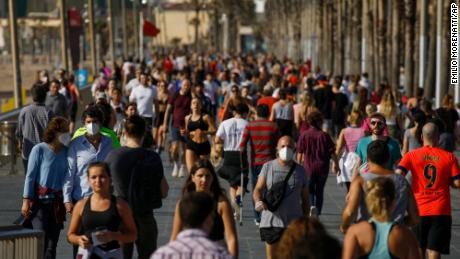 Spaniards soak up sun after lockdown eased, as daily death toll lowest in 6 weeks