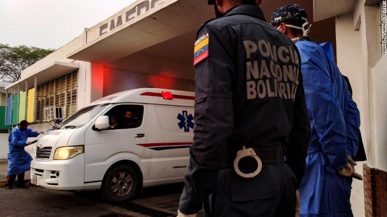 An ambulance arrives with prisoners outside a hospital after a riot erupted inside a prison in the Venezuelan state of Portuguesa.