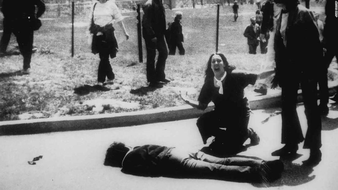 In this Pulitzer Prize-winning photo, taken by Kent State photojournalism student John Filo, Mary Ann Vecchio can be seen screaming as she kneels by the body of a slain student.