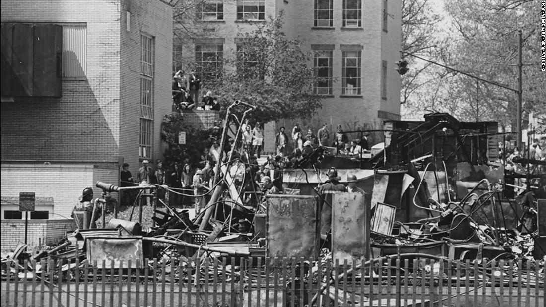 A night of violence in downtown Kent was followed by a student march to the campus ROTC building the next day. Some students tried to burn the building down. While the protesters claimed they left the building intact and in the hands of campus police when they returned to their dorms, the building was destroyed. It's still not clear who burned it down.