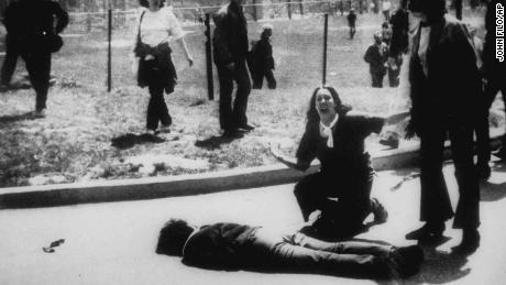Mary Ann Vecchio gestures and screams as she kneels by the body of a student lying face down on the campus of Kent State University on May 4, 1970.