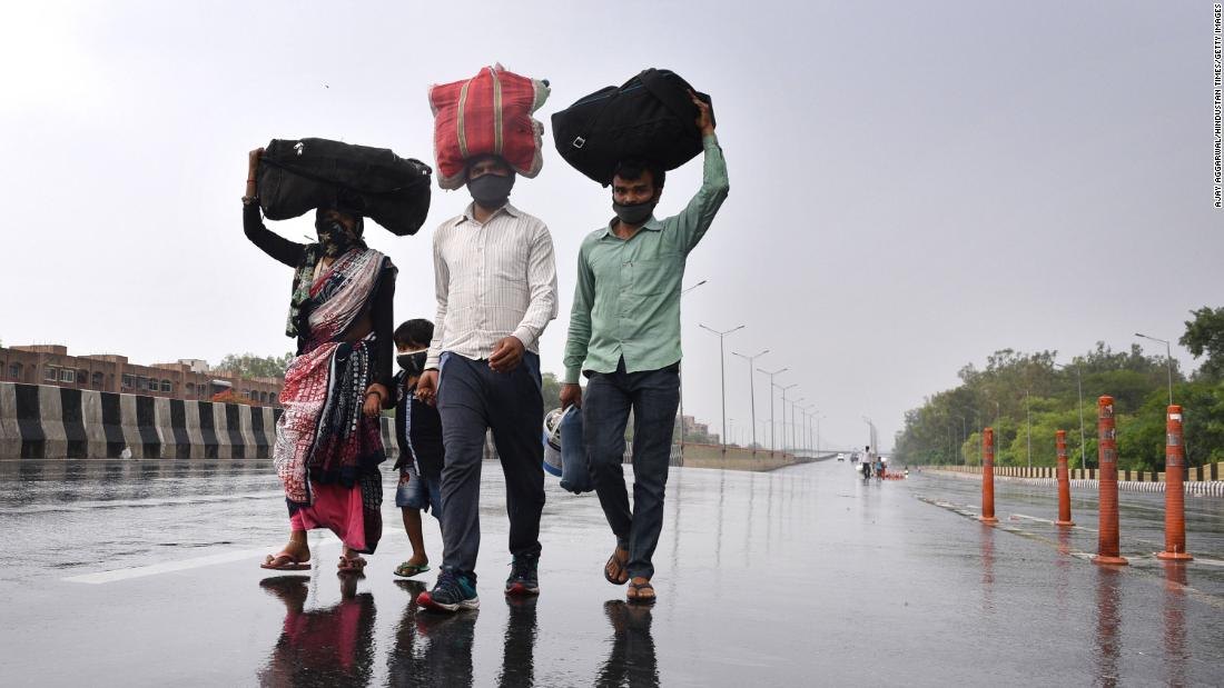 "Migrant workers in New Delhi walk toward the Sarai Kale Khan Bus Terminus on May 3 after learning that the government was preparing to send migrant workers back to their home states during the lockdown. In March, Prime Minister Narendra Modi <a href=""http://www.cnn.com/2020/03/30/india/gallery/india-lockdown-migrant-workers/index.html"" target=""_blank"">urged all states to seal their borders</a> to stop the coronavirus from being imported into rural areas."