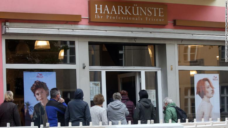 A line forms at a salon in Berlin on Monday after hairdressers were allowed to reopen.