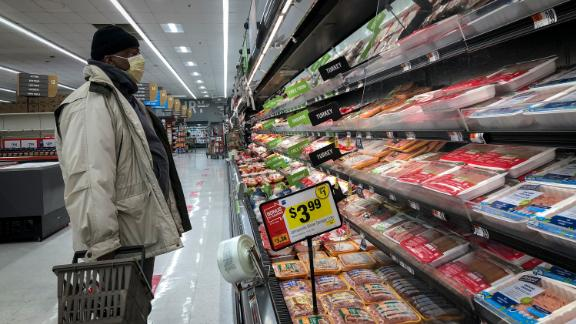 WASHINGTON, DC - APRIL 28: A man shops in the meat section at a grocery store, April 28, 2020 Washington, DC. Meat industry experts say that beef, chicken and pork could become scarce in the United States because many meat processing plants have been temporarily closed down due to the coronavirus pandemic. Tyson Foods took out a full page advertisement over the weekend in several major American newspapers, warning that the food supply chain is on the cusp of breaking. (Photo by Drew Angerer/Getty Images)