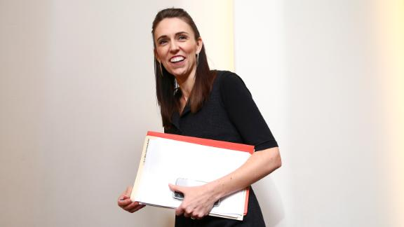 Prime Minister Jacinda Ardern speaks to a journalist as she exits a press conference at Parliament on April 30, 2020 in Wellington, New Zealand.