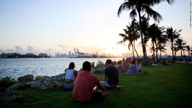 People gather for sunset in South Pointe Park on April 29, 2020 in Miami Beach, Florida.