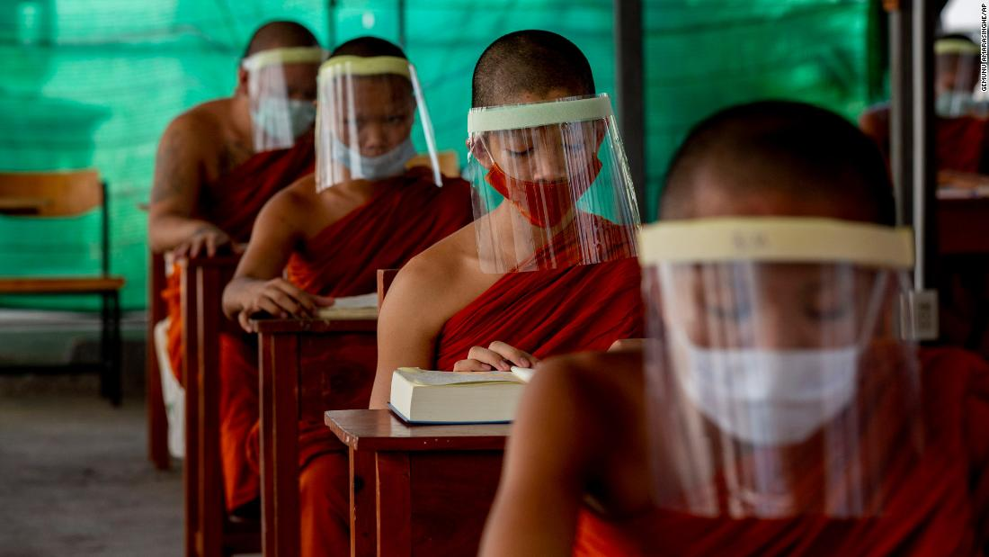 Novice Buddhist monks wear face shields at the Molilokayaram Educational Institute in Bangkok, Thailand, on April 15.