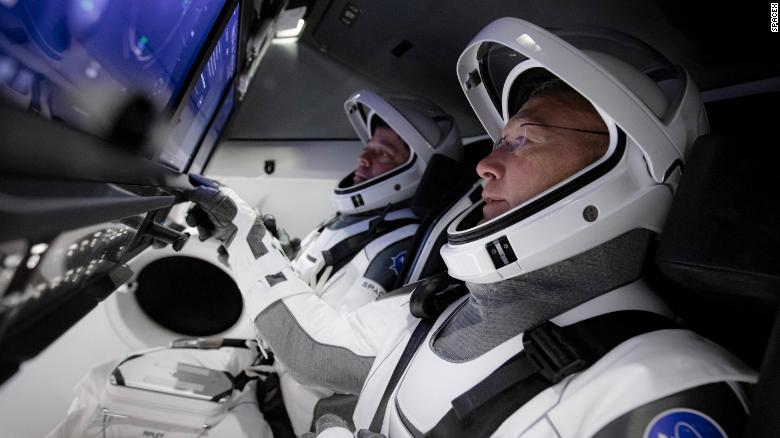 NASA astronauts Bob Behnken, left, and Doug Hurley have spent years learning how to operate SpaceX's Crew Dragon capsule.