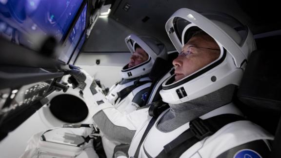 NASA astronauts Bob Behnken and Doug Hurley in SpaceX's flight simulator for the Crew Dragon launch.