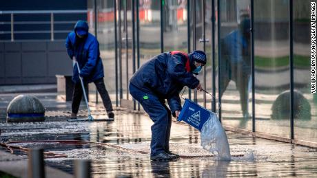 Workers clean a street in the center of Moscow on May 2.