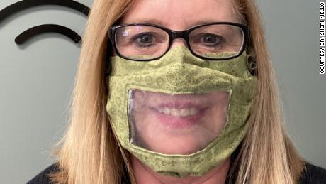 Dr. Sheri Mello handed out the clear masks to hearing-impaired patients.