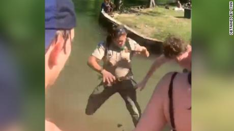 A park goer at Commons Ford Ranch Metro Park in Austin, Tex., shoved Cassidy Stillwell into a lake on April 30 after the park ranger asked a crowd to disperse to maintain social distancing.