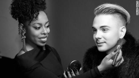Hair and makeup artist Angela Ivana at work on actor Kyle Vanzandt.