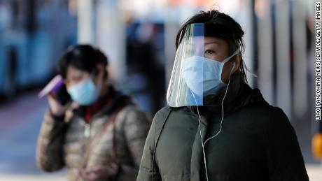 NEW YORK, NY - APRIL 06: A woman wearing face mask walks on the street at Flushing's Chinatown amid novel coronavirus outbreak on April 6, 2020 in New York City. (Photo by Liao Pan/China News Service via Getty Images)