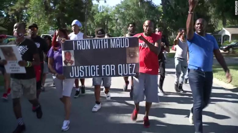 """Protesters chant, """"I run with Maud"""" Tuesday in the Satilla Shores, where Arbery was killed."""