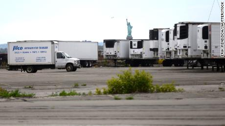 Trucks are seen Tuesday at a long-term morgue that opened at Brooklyn's 39th Street Pier in New York.