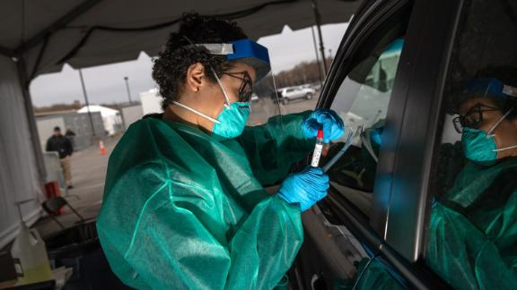 NEW YORK, NY - MARCH 28: A health worker handles a coronavirus swab test at a drive-thru testing center for COVID-19 at Lehman College on March 28, 2020 in the Bronx, New York City. The center, opened March 23 at Lehman College, can test up to 500 people per day for COVID-19. (Photo by John Moore/Getty Images)