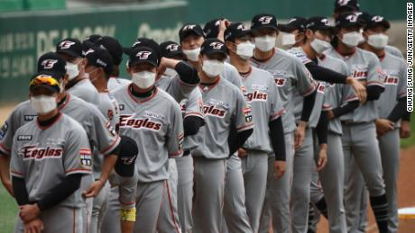 Hanwha Eagles players wear masks before the Korean Baseball Organization (KBO) League opening game between SK Wyverns and Hanwha Eagles.