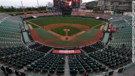 The SK Wyverns and the Hanwha Eagles play in an empty SK Happy Dream Ballpark on Tuesday, which was opening day for the Korean Baseball League.