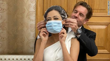 Putting mrs mask on: Ivan Watson puts a mask on Rana . Photo: Keith Richburg