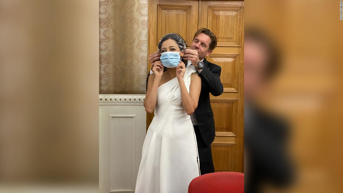 Ivan puts a surgical mask on new bride Rana. Photo: Keith Richburg