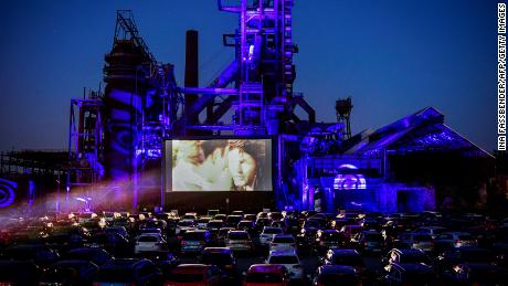 A picture taken in Dortmund, Germany, on April 17, shows cars at a newly opened drive-in cinema in front of a former Phoenix-West blast furnace.