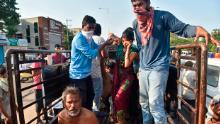 People affected by the gas leak are carried out of a truck to an ambulance in Vishakhapatnam.