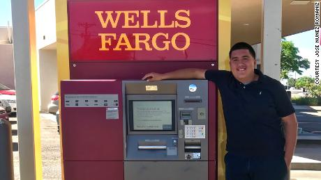 Nunez stands by the ATM where he found the bag.