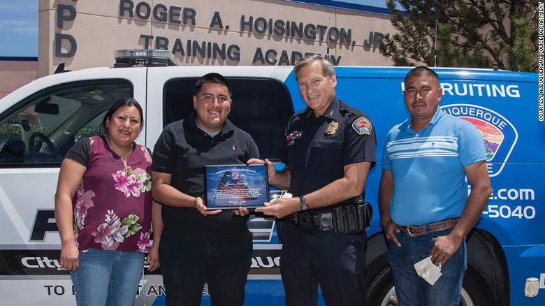 Albuquerque officials celebrated Jose Nunez's decision on Thursday. He holds a plaque presented by Police Chief Mike Geier. They are flanked by Nunez's parents, Carmen Romaniz and Jose Nunez Juarez.