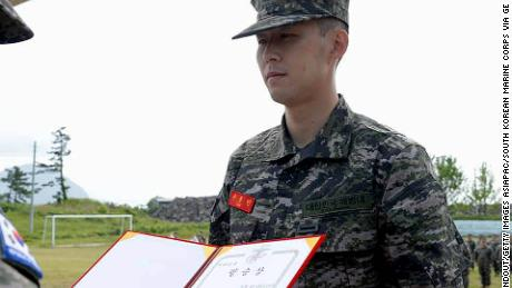 Son isn't just an award-winning footballer ... the Spurs stars receives a best performance prize during the Marines Corps completion ceremony.