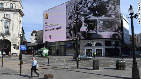 A VE Day tribute is displayed in London's deserted Piccadilly Circus on Friday.