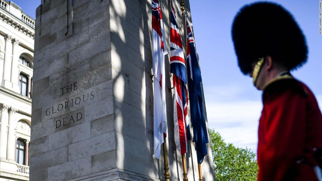 A member of the British Armed Forces stands next to The Cenotaph war memorial in London.