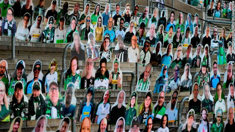 Cardboard cut-outs with portraits of Borussia Moenchegladbach's supporters are seen at the Borussia Park stadium.
