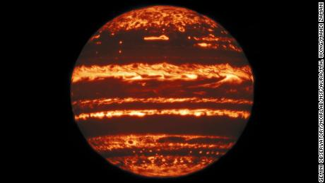 "This image showing the entire disk of Jupiter in infrared light was compiled from a mosaic of nine separate pointings observed by the international Gemini Observatory, a program of NSF's NOIRLabon 29 May 2019. From a ""lucky imaging"" set of 38 exposures taken at each pointing, the research team selected the sharpest 10%, combining them to image one ninth of Jupiter's disk. Stacks of exposures at the nine pointings were then combined to make one clear, global view of the planet. Even though it only takes a few seconds for Gemini to create each image in a lucky imaging set, completing all 38 exposures in a set can take minutes -- long enough for features to rotate noticeably across the disk. In order to compare and combine the images, they are first mapped to their actual latitude and longitude on Jupiter, using the limb, or edge of the disk, as a reference. Once the mosaics are compiled into a full disk, the final images are some of the highest-resolution infrared views of Jupiter ever taken from the ground."