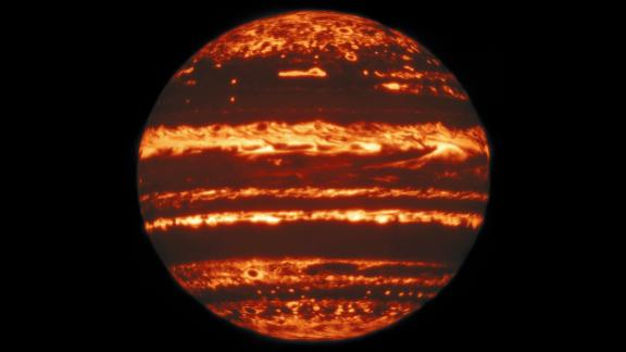 This jack-o-lantern-esque view of Jupiter is a mosaic of images taken by the Gemini North telescope in Hawaii. The bright spots represent Jupiter's internal heat escaping through holes in the planet's massive cloud cover.