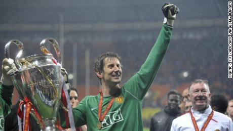 Van der Sar holds up the Champions League trophy after Manchester United beat Chelsea in the final on May 21, 2008.