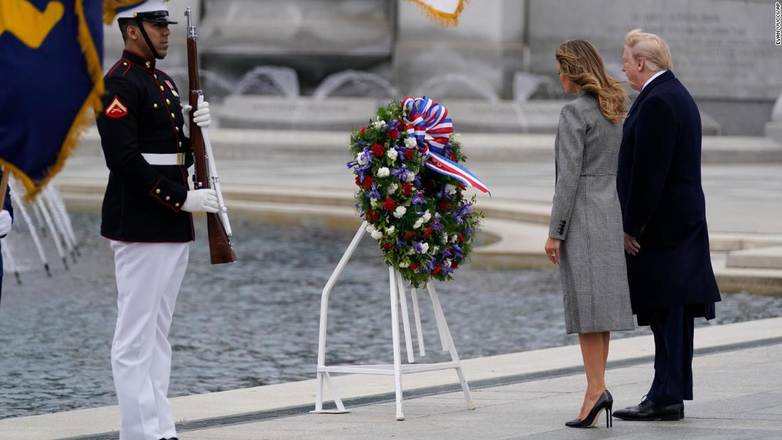 US President Donald Trump and first lady Melania Trump participate in a wreath-laying ceremony at the World War II Memorial in Washington.