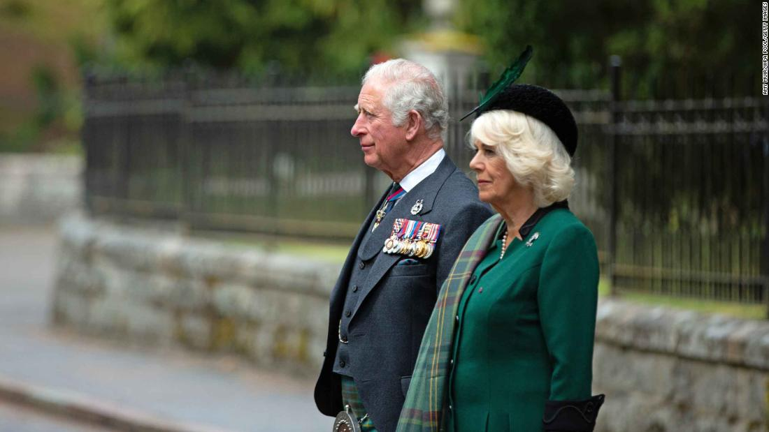 Britain's Prince Charles and his wife Camilla, the Duchess of Cornwall, take part in a two-minute silence at the Balmoral War Memorial near Crathie, Scotland.